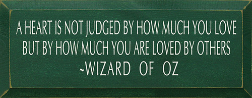 Wood Sign - A Heart Is Not Judged By How Much You Love But How Much ...