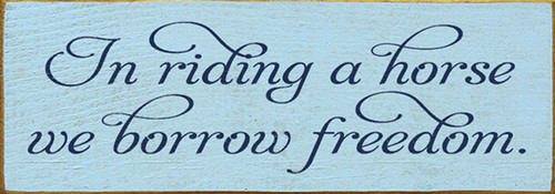 In Riding A Horse We Borrow Freedom Wood Sign