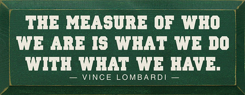 The measure of who we are is what we do with what we have. - Vince Lombardi Wood Sign