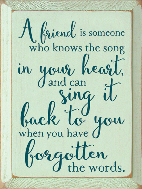 Wood Sign - A Friend Is Someone Who Knows The Song In Your Heart ...