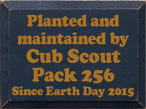 9x12 Navy Blue board with Gold text  Planted and Maintained By Cub Scout Pack 256 since Earth Day 2015