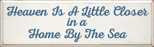 11x36 White board with Williamsburg Blue text  Heaven is a little closer in a home by the sea