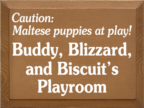9x12 Toffee board with White text Caution: Maltese puppies at play! Buddy, Blizzard, and Biscuit's playroom