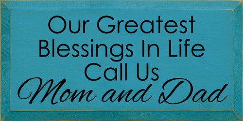 9x18 Turquoise board with Black text  Our greatest blessings in life call us mom and dad
