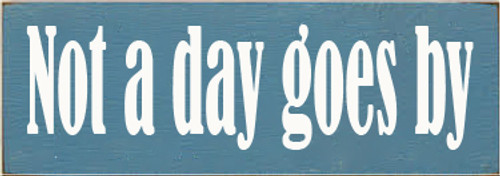 3.5x10 Williamsburg Blue board with White text  Not A Day Goes By