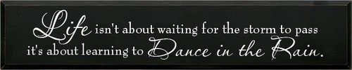 11x55 Black board with White text  Life Isn't About Waiting For The Storm To Pass It's About Learning To Dance In The Rain
