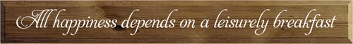 5.5x44 Walnut Stain board with White text  All Happiness Depends On A Leisurely Breakfast