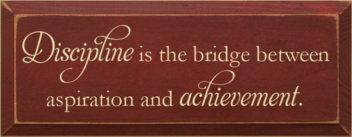 7x18 Burgundy board with Cream text  Discipline is the bridge between aspiration and achievement
