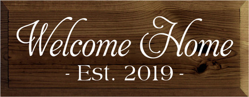 7x18 Walnut Stain board with White text  Welcome Home est. 2019