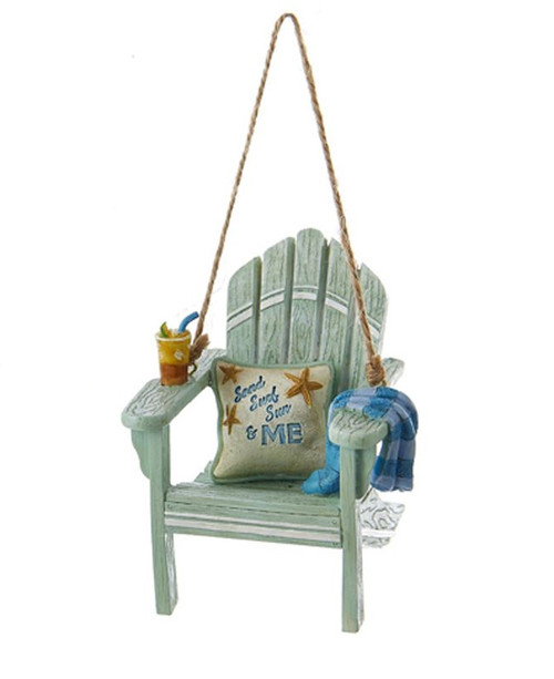 "Beach Chair Ornament - Sand Surf Sun & Me This beach chair ornament is a fun, unique way to add a nautical touch to your holiday décor! This design features a sea green beach chair with a mixed drink in its cup holder in one arm, a towel over the other arm and a pillow resting on the seat that reads ""Sand Surf Sun and Me."" Made of resin Perfect for those who love the beach! Item Size: 3-inches tall"