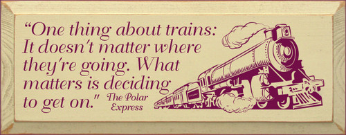 "7x18 Cream board with Raspberry text  ""One thing about trains: It doesn't matter where they're going. What matters is deciding to get on.""  The Polar Express"