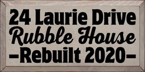 9x18 Putty board with Black text   24 Laurie Drive  Rubble House  Rebuilt 2020