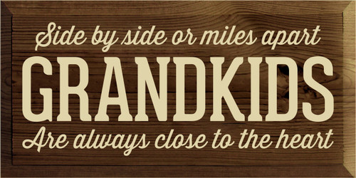 9x18 Walnut Stain board with Cream text  Side by side or miles apart GRANDKIDS Are always close to the heart