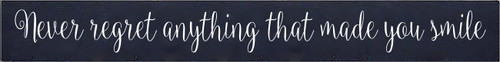 5x40 Navy Blue board with White text  Never regret anything that made you smile