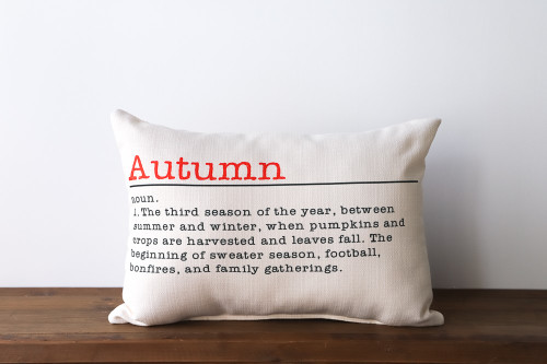 Autumn: Noun. 1. The third season of the year, between summer and winter, when pumpkins and crops are harvested and leaves fall. The beginning of sweater season, football, bonfires, and family gatherings. Rectangle Pillow