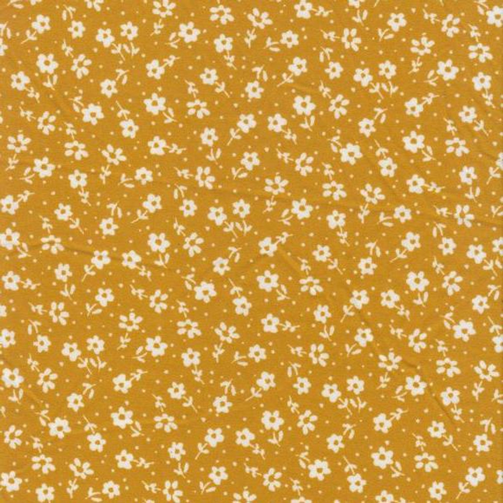 Ditsy floral on mustard double brushed poly