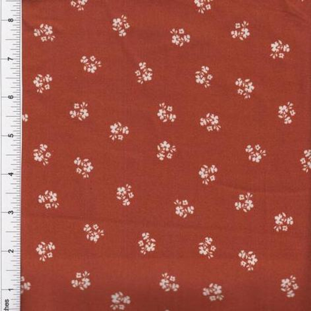 ditsy floral on rust