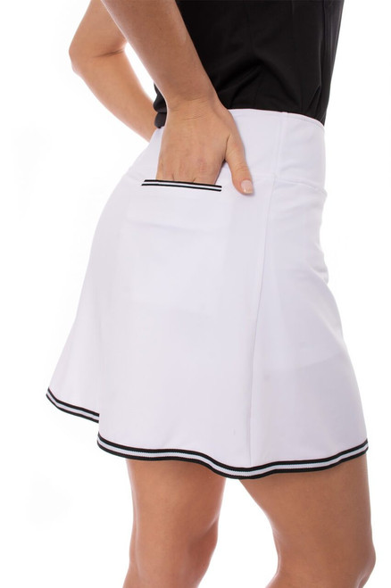 """Golftini Ice Ice Baby Pull-on Stretch Skort 16.5"""" A-Line sport skirt, designed for golf, tennis, pickle, or whatever court you're looking to play. This athleisure piece is classy in white with black trim, but also practical with an inner ball pocket, large back pocket, and hidden front pocket. Crossover in style."""
