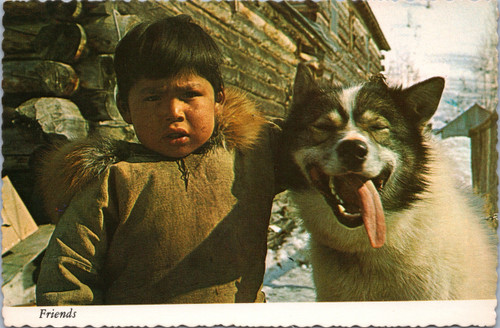 Eskimo boy and Husky