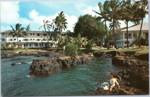 Woman sitting in Hilo Bay at Naniloa Hotel