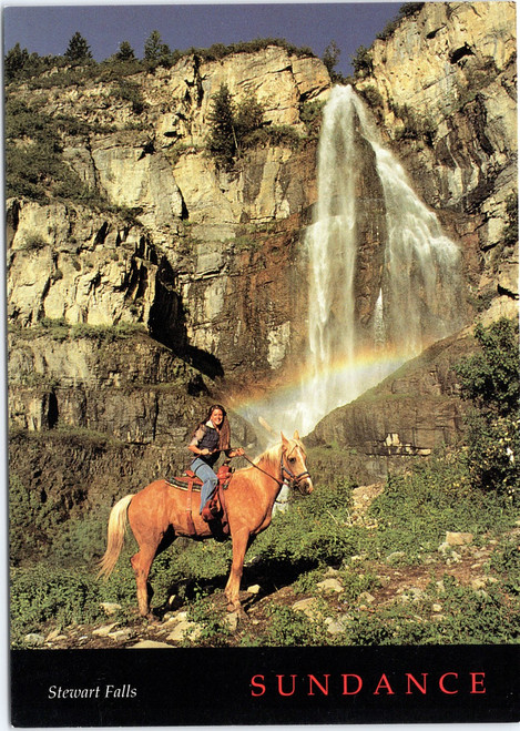 Woman horseback riding at Stewart Falls in Utah