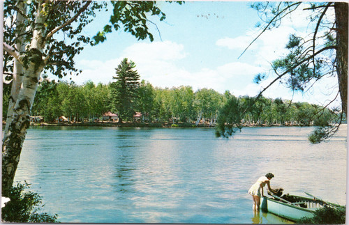 Woman getting into rowboat at Fish Creek public campground
