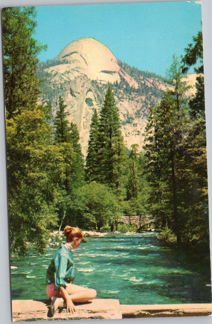 Woman sitting by Merced River