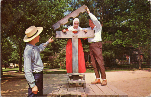 putting woman into pillory stocks