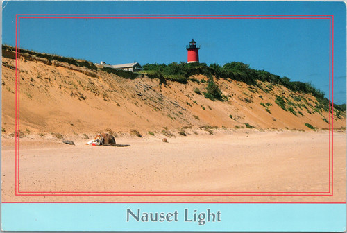 Nauset Light with person on beach