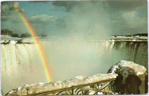 Canadian Falls during winter with rainbow