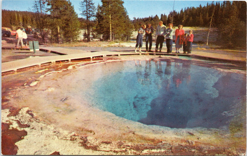 Yellowstone - tourist observing Morning Glory Pool