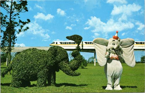 Dumbo strolling topiary lane