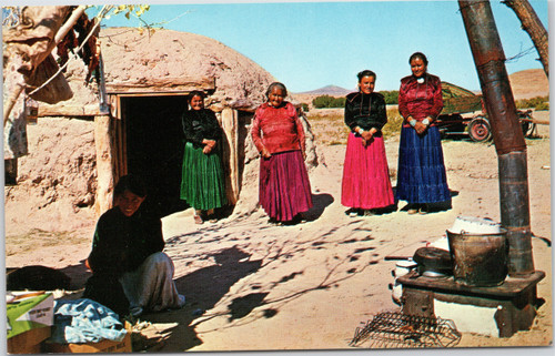 Navajo Women next to mud house, Hogan