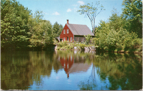 Red mill on pond