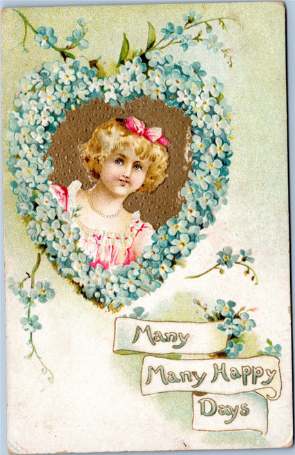 Many Happy Days - Girl in heart shaped boquet of forget-me-nots