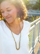 Long recycled bullet casing necklace in gold   Fair Anita