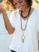 Long recycled bullet casing necklace in brass | Fair Anita