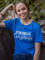 "Bright blue t- shirt that says ""kindness is everything "" in a trendy font. Fair Anita"