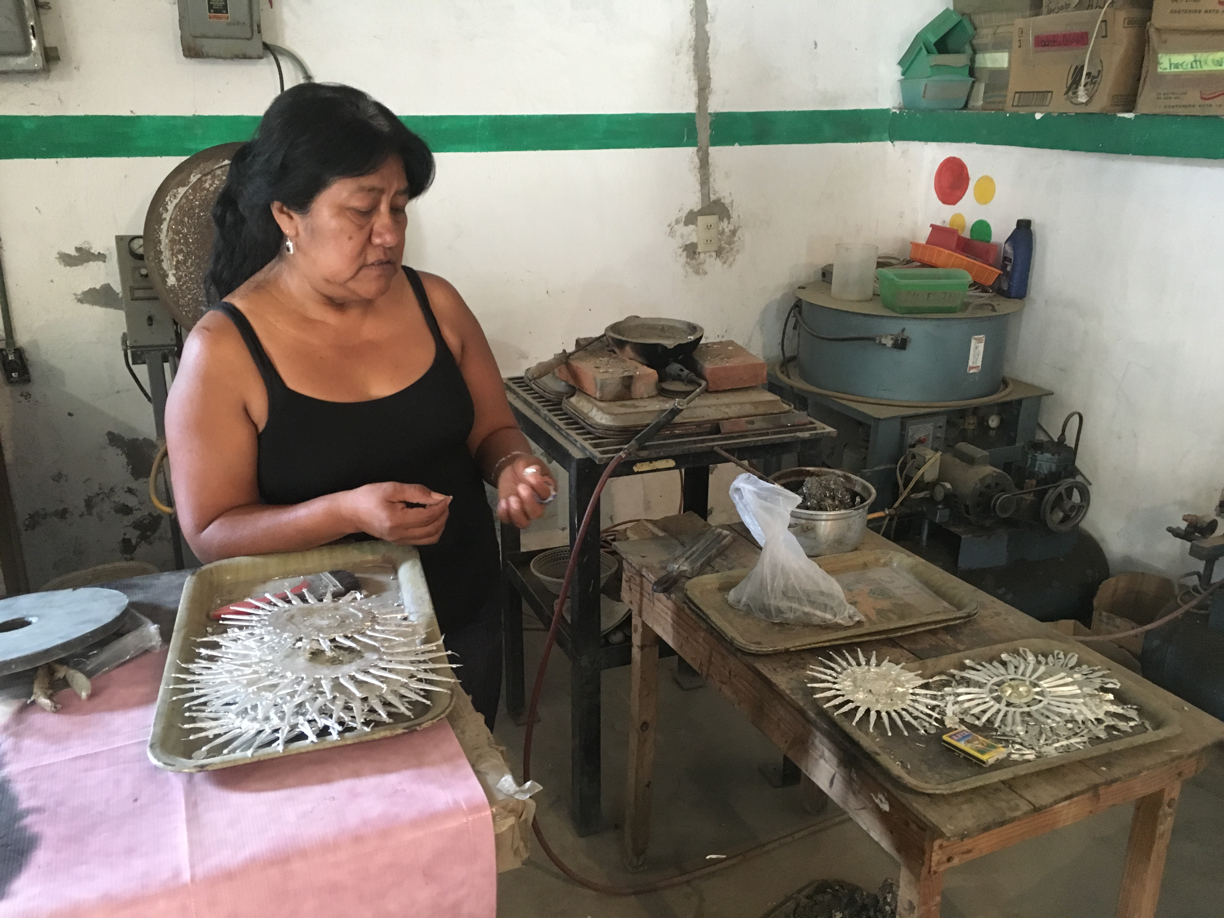Paula a fair trade artisan in Mexico, working on jewelry in her workshop | Fair Anita