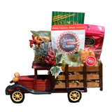 Old-fashioned pick up truck filled with Christmas treats.