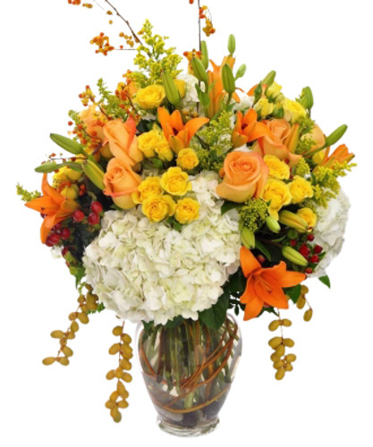 Large luxurious arrangement in fall colors dripping with style!