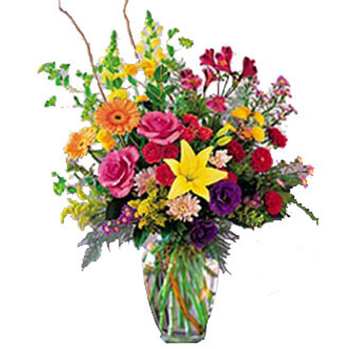brightly colors of wild flowers in a clear vase