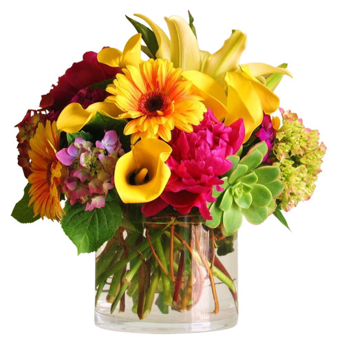 Bright & Beautiful features bold fresh blooms in yellows and pinks in a large cylinder vase.