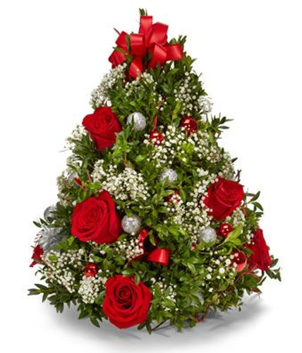 The Perfect mini table top tree filled with red roses and baby's breath.