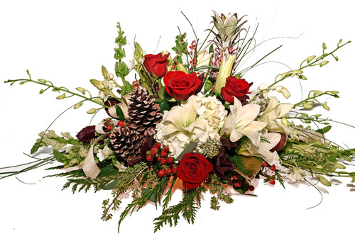Amazing custom Holiday Bounty Centerpiece with lilies, orchids & min pineapple ornamental' s.