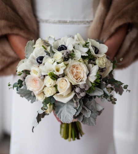 Grays, blush and whites create the perfectly sophisticated bride's bouquet.