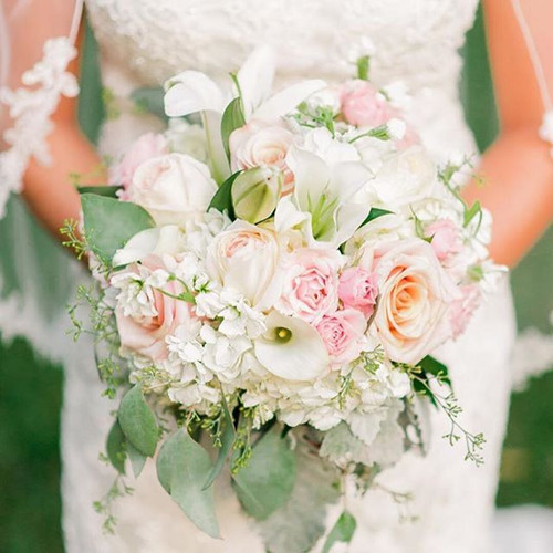 The Lauren Bridal Bouquet is a luxurious, large bouquet featuring soft pinks & ivories.