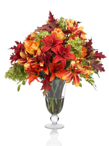 Lilies, hydrangeas in a fall flower arrangement