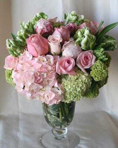 Luxurious pinks and greens including peonies, parrot tulips, roses and hydrangeas