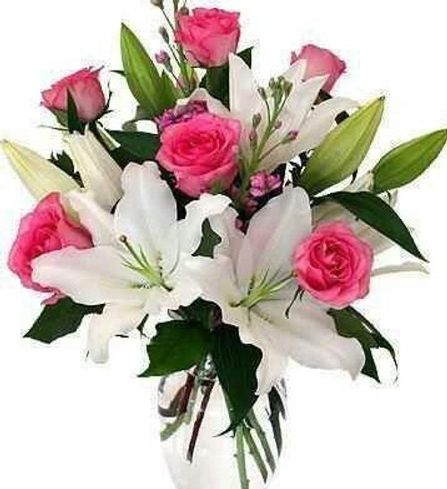 Pink roses and beautiful white lilies make this bouquet special.